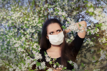 Woman with Allergy with Respirator Mask