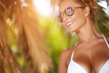 Portrait of attractive female wearing stylish sunglasses hug pal
