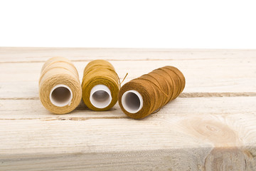 Sewing thread on a wooden table