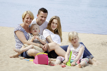 Family spends a day at the beach.