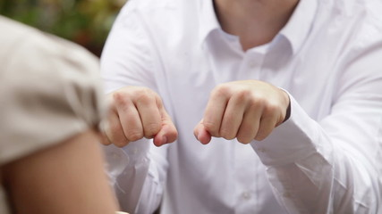man open fists and show the ring and woman take one ring and guy