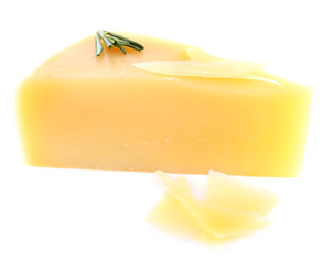 Chunk of Parmesan cheese with sprig of rosemary isolated