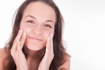 woman using moisturizer - wellness - skincare
