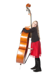 young girl embraces double bass in studio