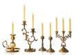 Leinwandbild Motiv Retro candlesticks with candles, isolated on white