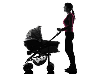 woman prams baby looking up surprised  silhouette