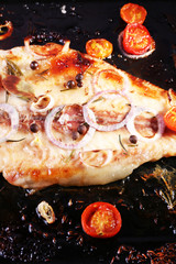 Dish of Pangasius fillet with onion and cherry tomatoes