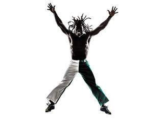 Brazilian  black man jumping arms outstretched silhouette