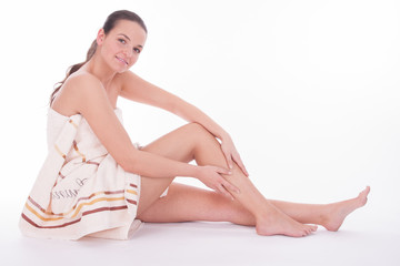 Well beeing - Wellness - Woman with towel sitting on floor