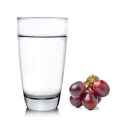 grapes and glass of water isolated on over white background