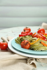 Tasty pasta with pepper, carrot and tomatoes