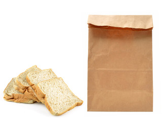 Brown paper bag and Brown bread slice  isolated on white