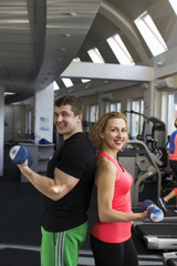 Fitness couple working out in the gym