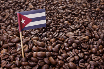 Flag of Cuba sticking in coffee beans.(series)