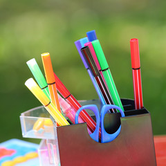 Colored marker pens. Holder basket and office supplies