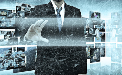 businessman holding a touch screen interface in the old texture