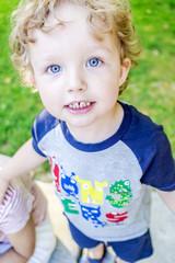 big blue eyes of one happy boy