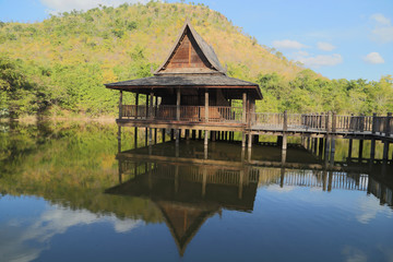 wood Thai pavilion reflect in pool