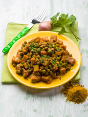 seitan stew with peas and curry, vegetarian food
