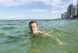 teenage boy enjoys swimming
