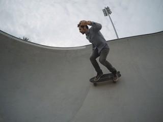Skater rides in pool