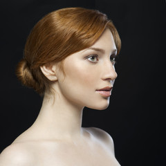 Redhead woman on dark background