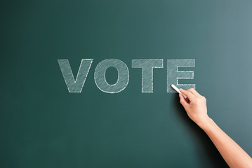 vote written on blackboard