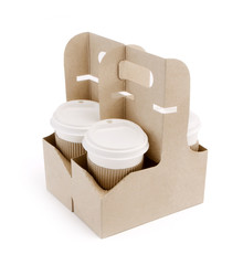 Take-out coffee in holder on white background.