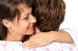 Patient and caregiver hugging