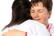 Senior woman and doctor hugging