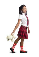 schoolgirl holding a teddy bear