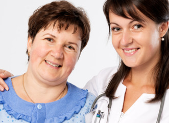 Senior woman with nurse at hospital smiling