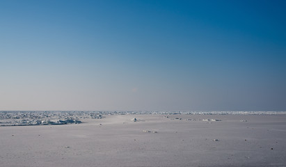 Frozen sea view on sunny day.