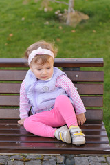 Thoughtful Girl on Bench