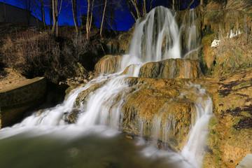 Night scene with waterfall