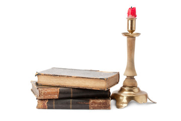 old book and candlestick