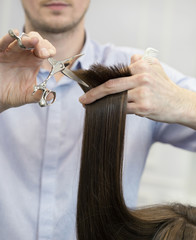 A hairdresser making a haircut