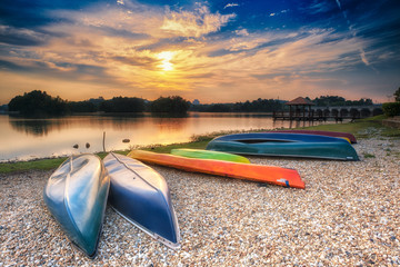 Parked Canoes by the lake at Sunset