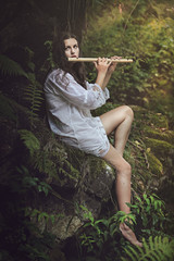 Dryad playing flute after the rain