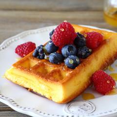 Homemade waffles with raspberries, blackberries, blueberries