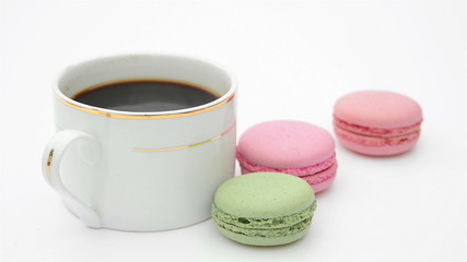 cup of coffee and macaroons sliding in