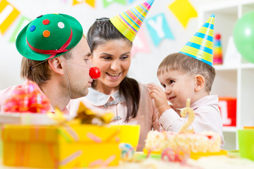family play game celebrating child birthday