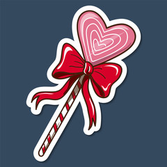 Heart shaped lollypop with bow.