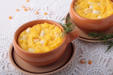 Bowl of baked polenta with cheese