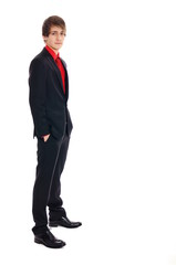 Young businessman standing on white background