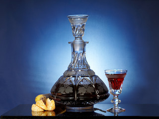 Glassware with liqueur and fruits