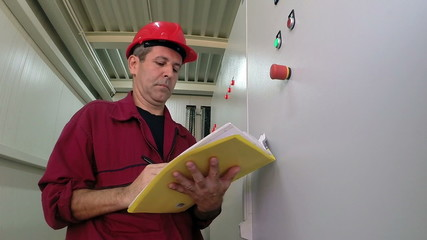 Engineer Writing in Plant Electrical Room