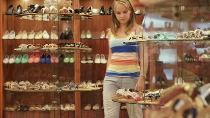 Young Female Doing Shopping Buying Shoes In Store