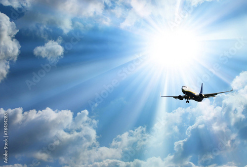 Silhouette of airplane with a beautiful sky - 76434283