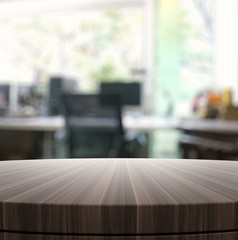 Empty wooden round table and blurred background for product pres